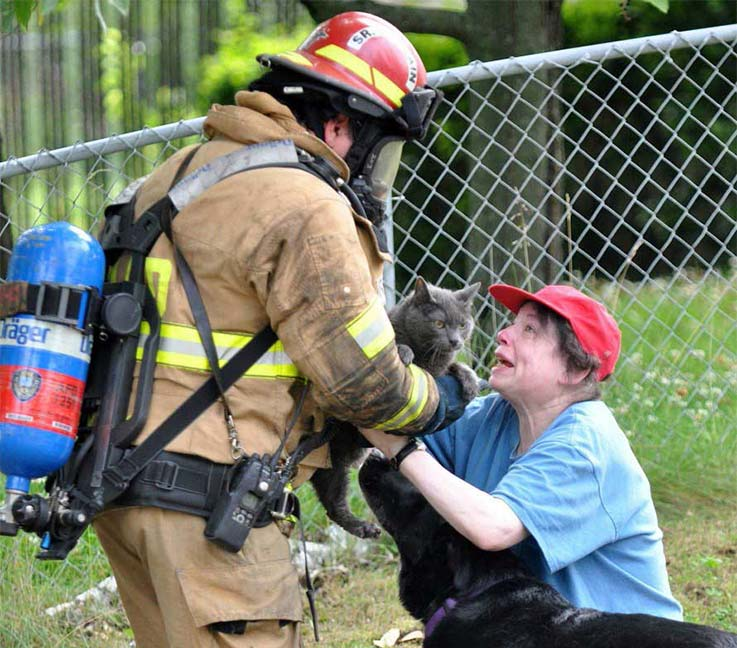 3. This Firefighter saved a kitten from a burning house.