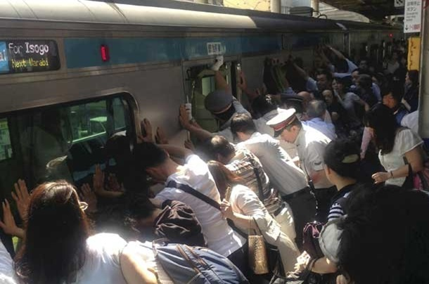 5. Dozens of commuters help free woman trapped under train in Japan