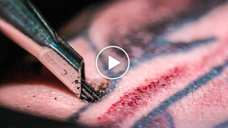 Super Slow Motion, Close-Up Video of a Tattoo Being Created.