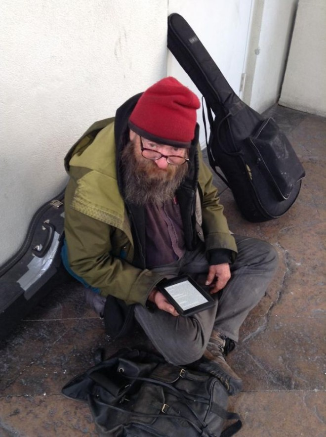 This homeless read the same book and then a kindly passerby gave the Kindle's.