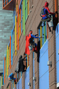 Workers in Memphis wearing superhero costumes to entertain children hospital.