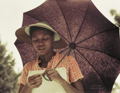 Young girl with umbrella in Louisiana, 1937