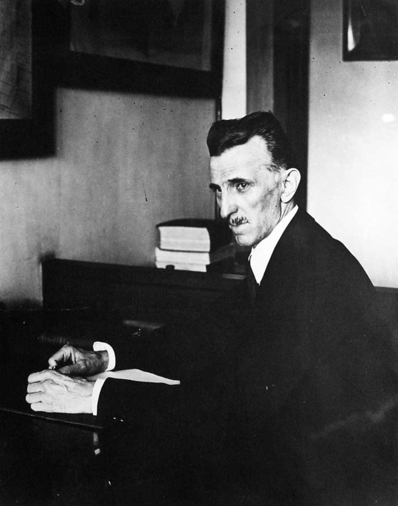 Nikola Tesla photographed working in his office at 8 West 40th Street. The image was taken in 1916.