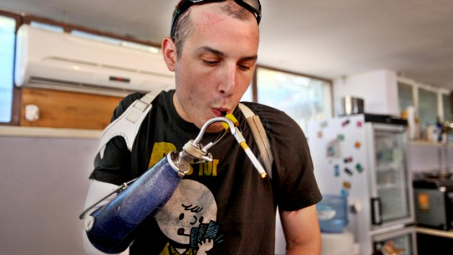 An injured IDF soldier uses medical cannabis (photo credit: Abir Sultan/Flash90)