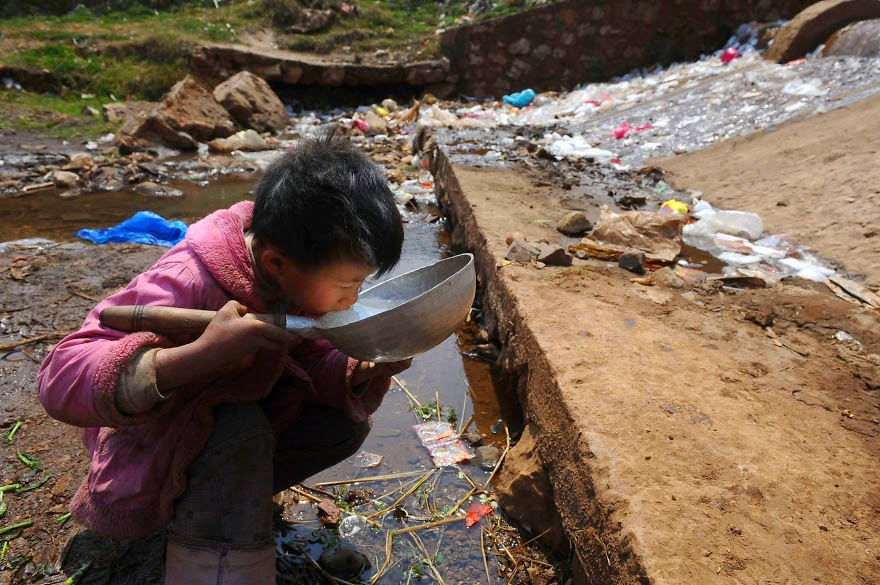 Child Drinks Polluted Water