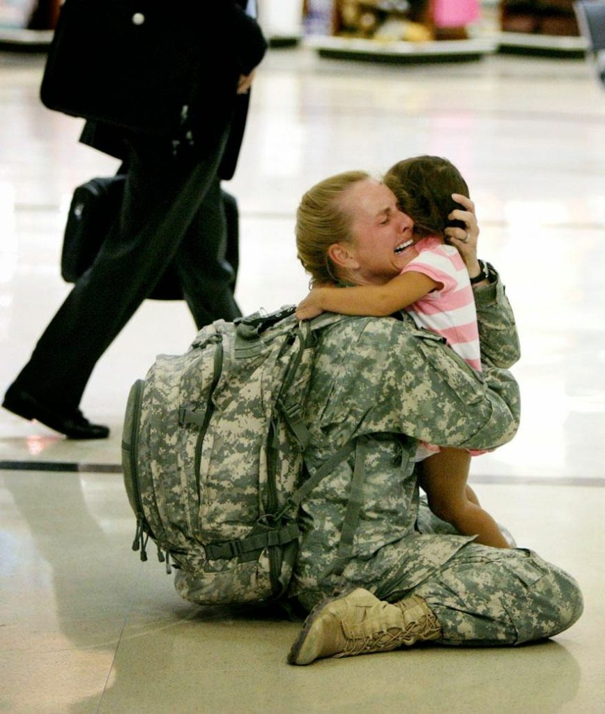 30 of the most powerful images of all time - Terri Gurrola is reunited with her daughter after serving in Iraq for 7 months
