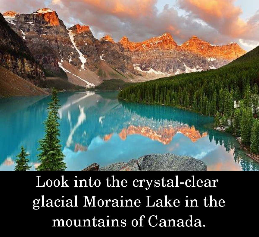 Look into the crystal-clear glacial Moraine Lake in the mountains of Canada.