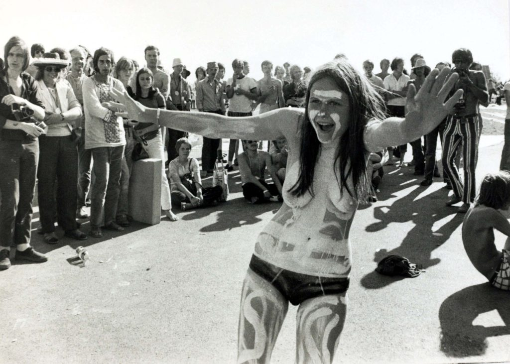 A young woman topless and covered in body paint at the Music Festival of the Rising Sun at Mantorf, Sweden ,1970