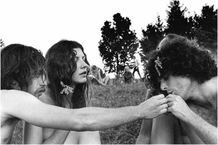 Hippies passing a joint