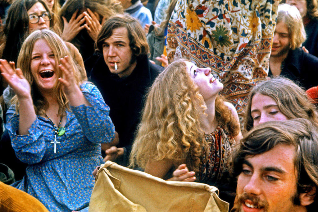 The crowd cheer as musical acts perform at the Altamont Speedway Free Festival, 1969
