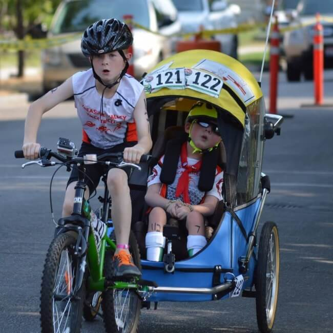 17. This boy finished a mini-triathlon together with his disabled brother.