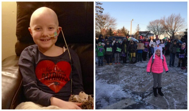20. Hundreds of people are welcoming this girl who had bravely defeated cancer on her first day back at school.