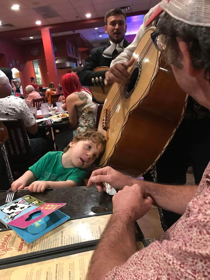 A Mariachi aMusician Let My Hard Of Hearing Son Put His Head On The Guitarron So He Could Hear It. He Was Amazed!