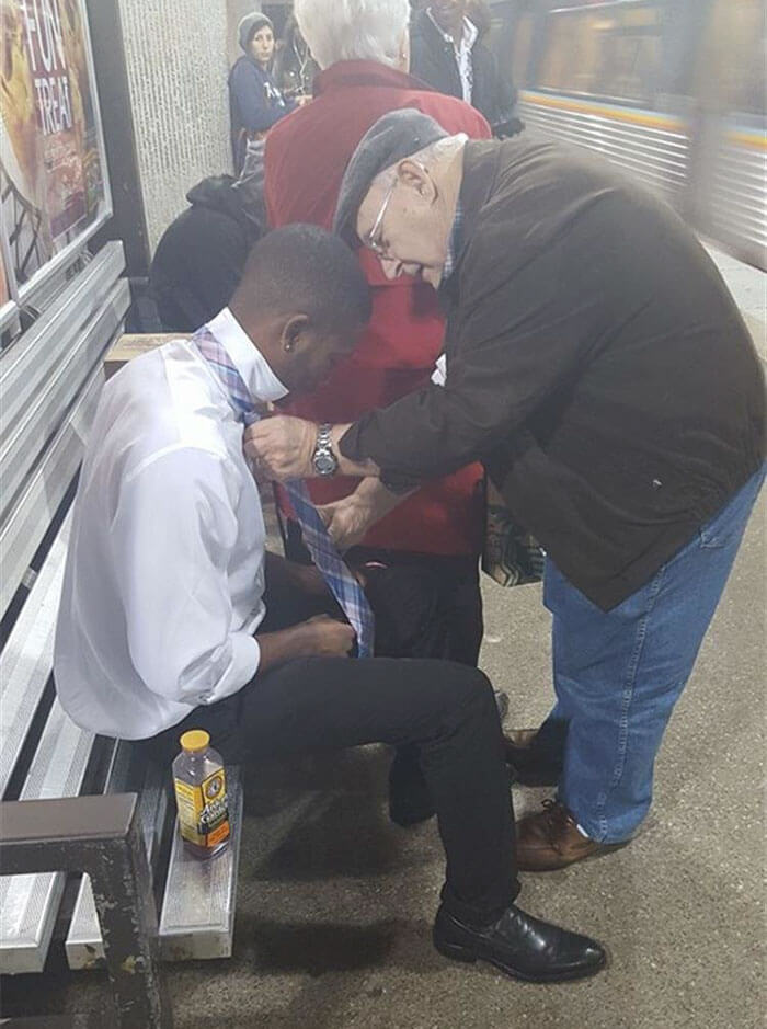 A Stranger Helping Out Another Stranger Struggling With His Tie
