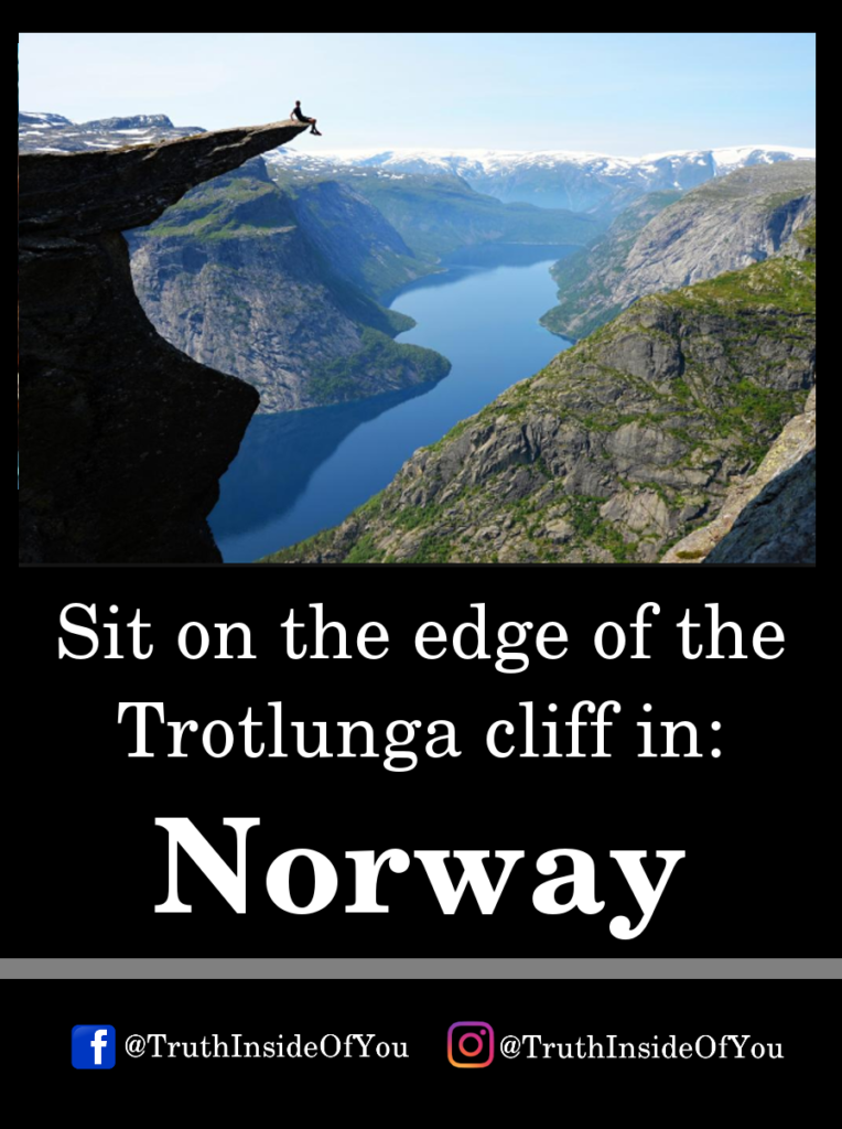 Sit on the edge of the Trotlunga cliff in_ Norway