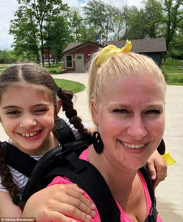 Teacher Carries Student with Cerebral Palsy on School Hiking Trip-1