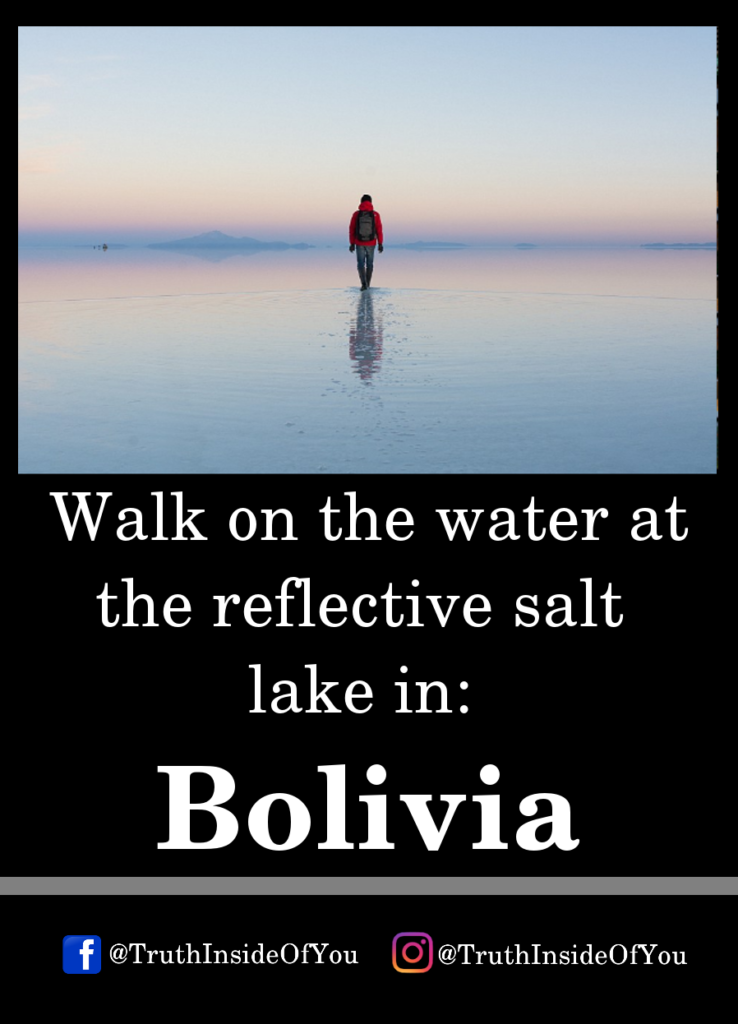 Walk on the water at the reflective salt lake in_ Bolivia