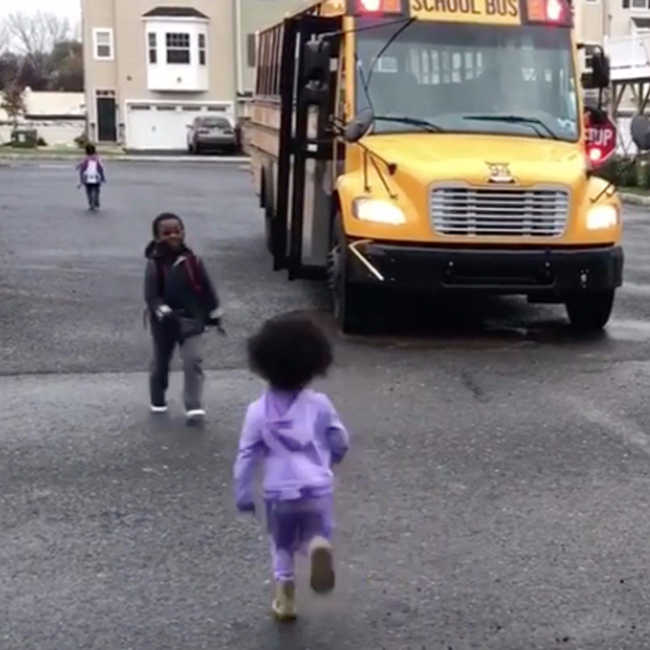 Little Sister Waits For Her Big Brother To Get Off The School Bus-1