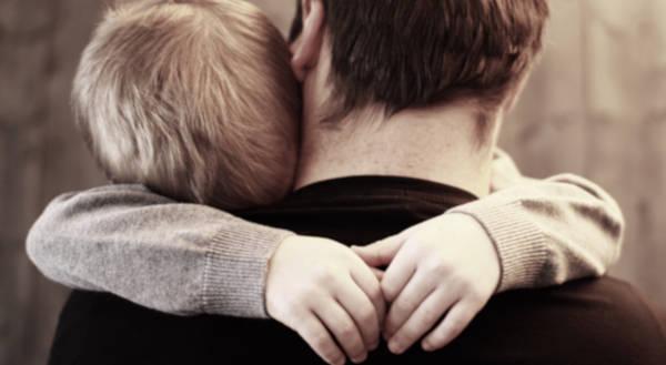 dad hugs kid