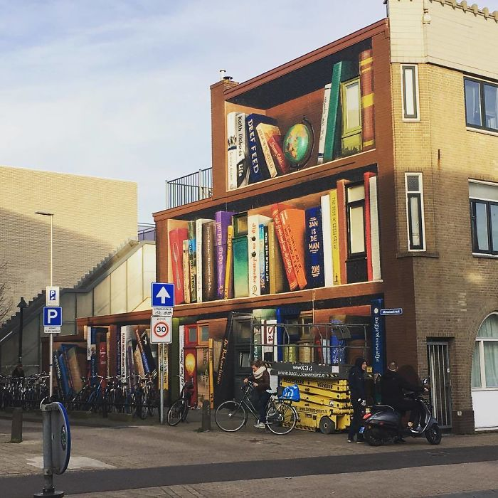Dutch Artist Paints A Giant Bookcase On The Walls Of A Building And People Are Amazed - 10