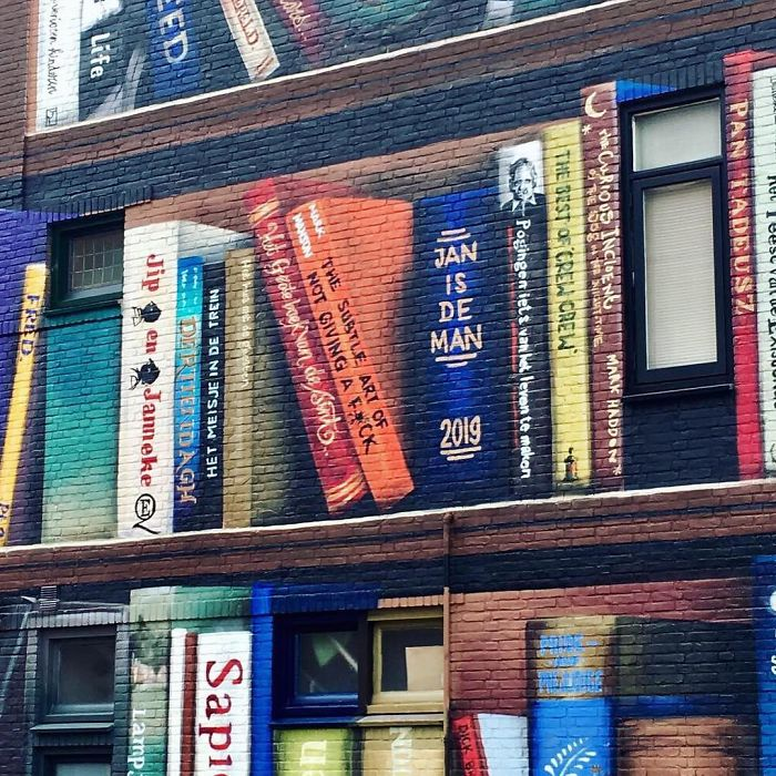 Dutch Artist Paints A Giant Bookcase On The Walls Of A Building And People Are Amazed - 12