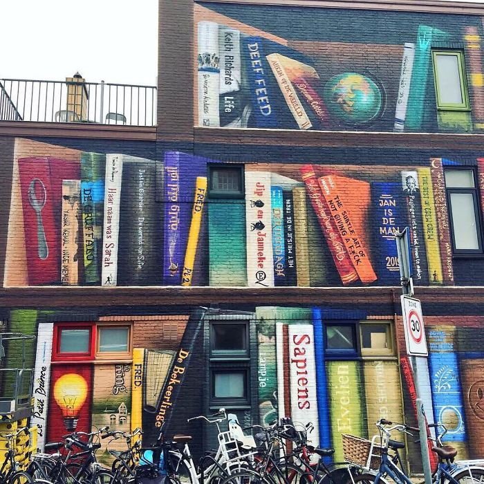 Dutch Artist Paints A Giant Bookcase On The Walls Of A Building And People Are Amazed - 4