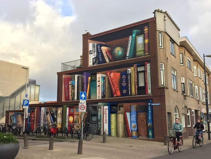 Dutch Artist Paints A Giant Bookcase On The Walls Of A Building And People Are Amazed - 5