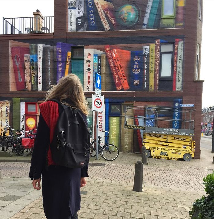 Dutch Artist Paints A Giant Bookcase On The Walls Of A Building And People Are Amazed - 6