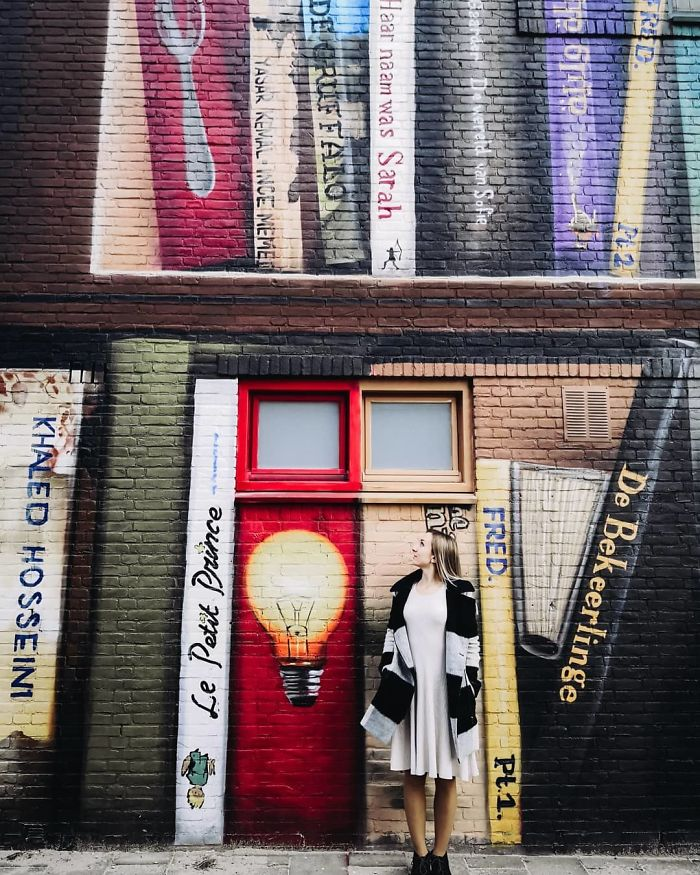 Dutch Artist Paints A Giant Bookcase On The Walls Of A Building And People Are Amazed - 7