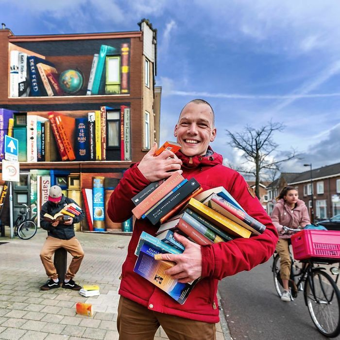 Dutch Artist Paints A Giant Bookcase On The Walls Of A Building And People Are Amazed - 9